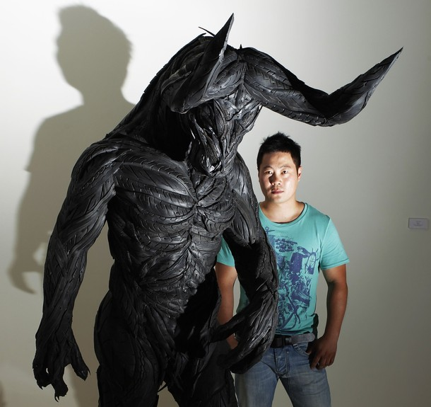 "Artist Ji Yong Ho poses with his sculptue ""Bullman 4"" before the launch of the Korean Eye : Fantastic Ordinary exhibition at the Saatchi Gallery in Chelsea west London"